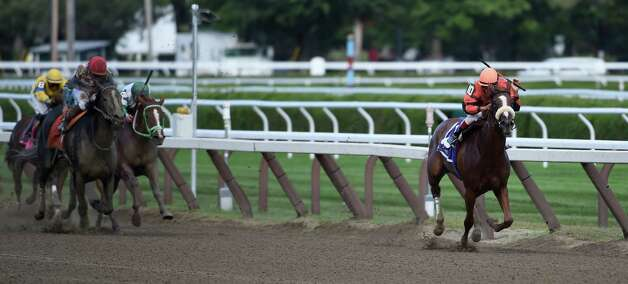 Jockey John Velazquez looks around for the competition on the way to the win in the 12th running of The Union Avenue on Tricky Zippy at the Saratoga Race Course Thursday afternoon Aug. 20, 2015. (Skip Dickstein/Times Union) Photo: SKIP DICKSTEIN