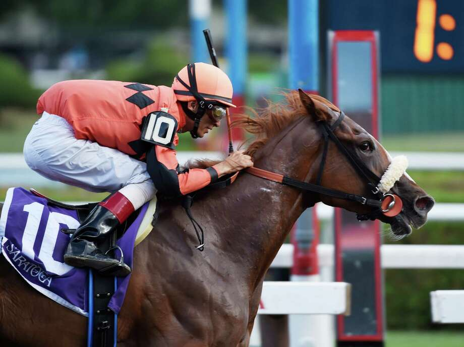 Jockey John Velazquez wins by a wide margin in the 12th running of The Union Avenue on Tricky Zippy at the Saratoga Race Course Thursday afternoon Aug. 20, 2015. (Skip Dickstein/Times Union) Photo: SKIP DICKSTEIN
