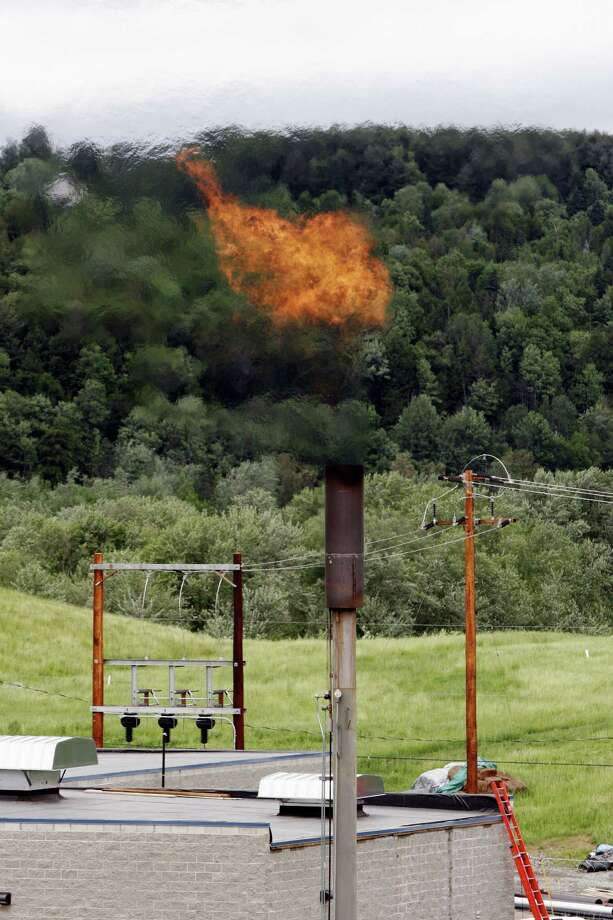 In this June 15, 2005 photo, methane gas burns off a stack near the Washington Electric Cooperative power plant in Coventry, Vt.  (AP Photo/Toby Talbot) Photo: Toby Talbot, STF / AP