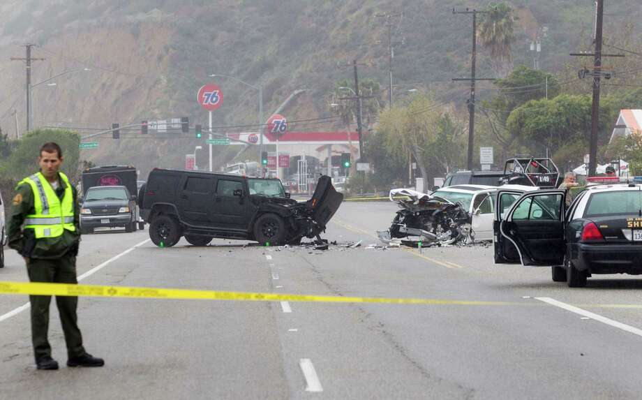 "FILE - In this Saturday, Feb. 7, 2015 file photo, Los Angeles County Sheriff's deputy guards the scene of a collision involving three vehicles in Malibu, Calif. Sheriff's investigators plan to recommend prosecutors file a vehicular manslaughter charge against Caitlyn Jenner for her role in the fatal car crash on the Pacific Coast Highway in Malibu last February. Los Angeles County Sheriff's Department spokeswoman Nicole Nishida says investigators found that Jenner was driving ""unsafe for the prevailing road conditions"" because her SUV rear-ended a Lexus, pushing it into oncoming traffic.  (AP Photo/Ringo H.W. Chiu, File) Photo: Ringo H.W. Chiu, FRE / Associated Press / FR170512 AP"