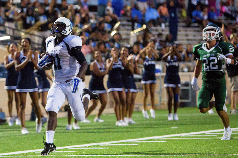 The running abilities of Elsik's E.J. Davis, left, set him apart from the rest. Photo: Cody Duty, Staff / © 2014 Houston Chronicle