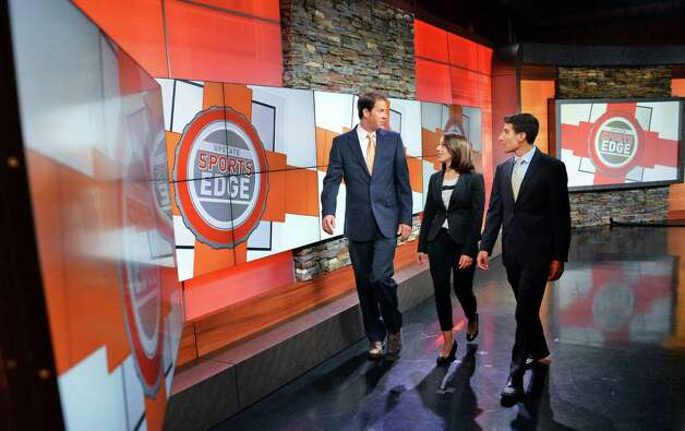 Host Kelly O'Donnell, left, Brittany Devane and Jason Lewis, right, on the set of Upstate Sports Edge at the WRGB Studios Thursday August 20, 2015 in Schenectady, NY.  (John Carl D'Annibale / Times Union) Photo: John Carl D'Annibale / 00033068A