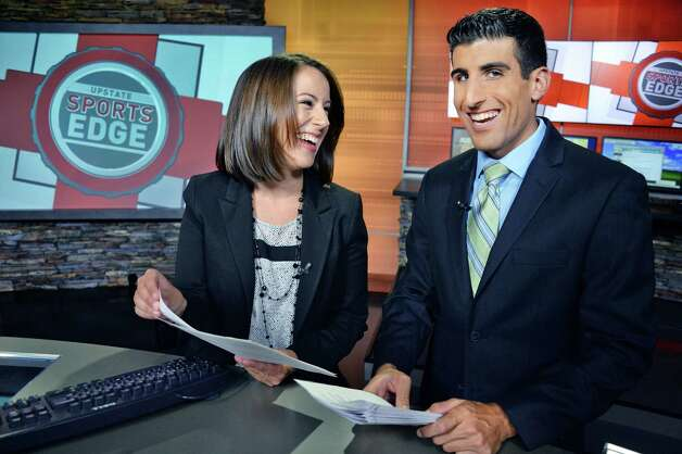 Brittany Devane, left, and Jason Lewis on the set of Upstate Sports Edge at the WRGB Studios Thursday August 20, 2015 in Schenectady, NY.  (John Carl D'Annibale / Times Union) Photo: John Carl D'Annibale / 00033068A