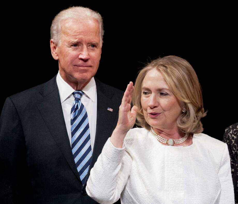 FILE - In this April 2, 2013 file photo, Vice President Joe Biden and former Secretary of State Hillary Rodham Clinton appear onstage at the Kennedy Center for the Performing Arts in Washington. Over the past quarter century or so, Hillary Rodham Clinton and Joe Biden have collaborated and competed, shared more than a dozen staff members, and served in a presidential Cabinet. Now, their long and tangled relationship is being tested.  (AP Photo/Cliff Owen, File) Photo: Cliff Owen, FRE / FR170079 AP