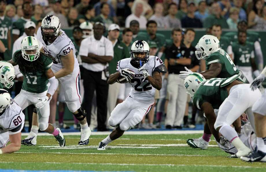 UConn running back Arkeel Newsome (22) breaks for a big gain against Tulane during an NCAA college football game in New Orleans last season. Newsome, a sophomore from Ansonia, is expected to start for the Huskies this season. Photo: A.J. Sisco / Associated Press / Associated Press