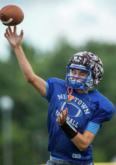 Newtown High School quarterback Justin Dunn thowing a pass during ...