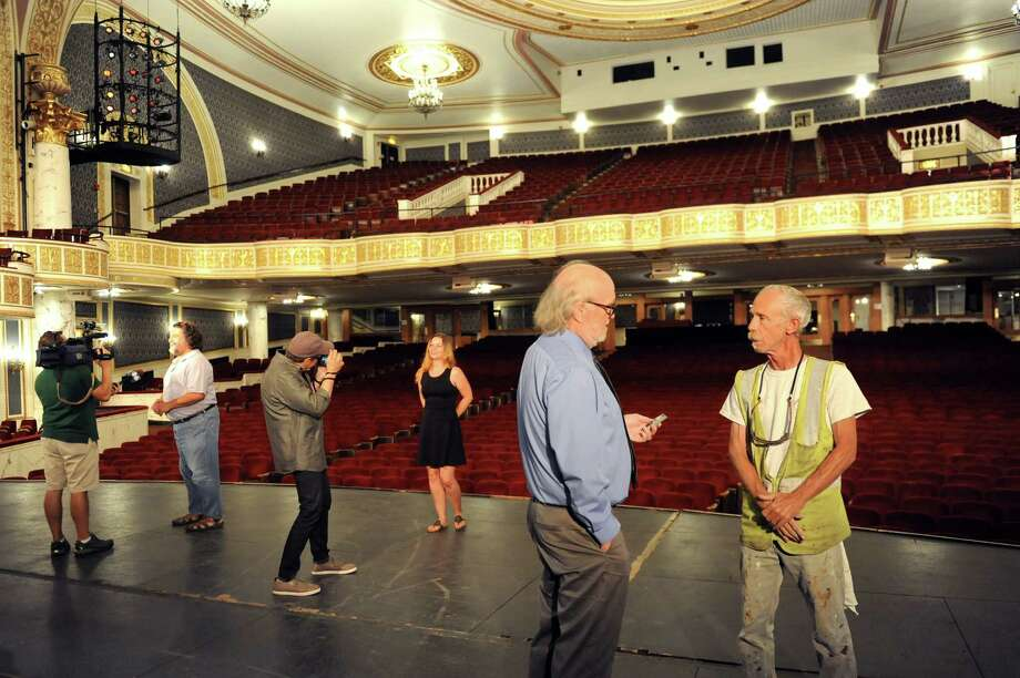 Jed Ellis, site supervisor of Evergreene Architectural Arts, right, is interviewed about the restoration of the Dutch gold leaf on the balcony on Thursday, Aug. 20, 2015, at Proctors Theatre in Schenectady, N.Y. The media was invited to view the restored balcony before lighting equipment permanently obscures the view. (Cindy Schultz / Times Union) Photo: Cindy Schultz / 00033050A
