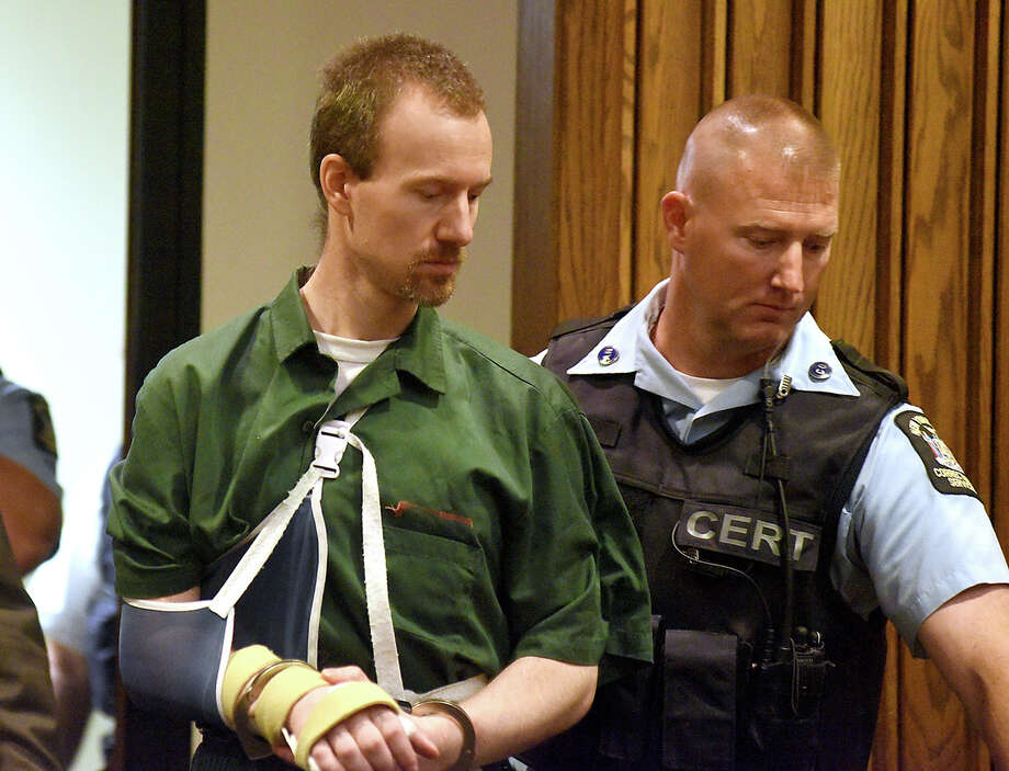 David Sweat is led into Clinton County Court, Thursday, Aug. 20, 2015, in Plattsburgh, N.Y. Sweat, a convicted killer who escaped June 6 from the Clinton Correctional Facility and spent more than three weeks on the run, was arraigned Thursday on criminal charges stemming from the breakout. Sweat pleaded not guilty to first-degree escape and promoting prison contraband. He is due back in court on Sept. 29. (Rob Fountain/Press-Republican via AP) MANDATORY CREDIT ORG XMIT: NYPLA102 Photo: Rob Fountain / Press-Republican