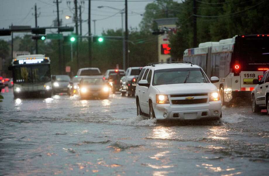 Traffic makes its way slowly down Washington Avenue as rain floods the area Thursday. Much of the area got about 4 inches of rain; some sites got as much as 10 inches of rainfall, weather observers say. Photo: Cody Duty, Staff / © 2015 Houston Chronicle