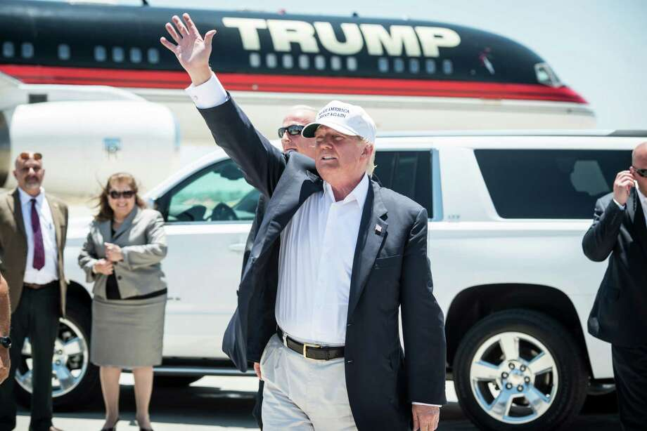 Republican Presidential candidate and business mogul Donald Trump exits his plane during his trip to the border on July 23, 2015 in Laredo, Texas. Photo: Matthew Busch, Stringer / 2015 Getty Images
