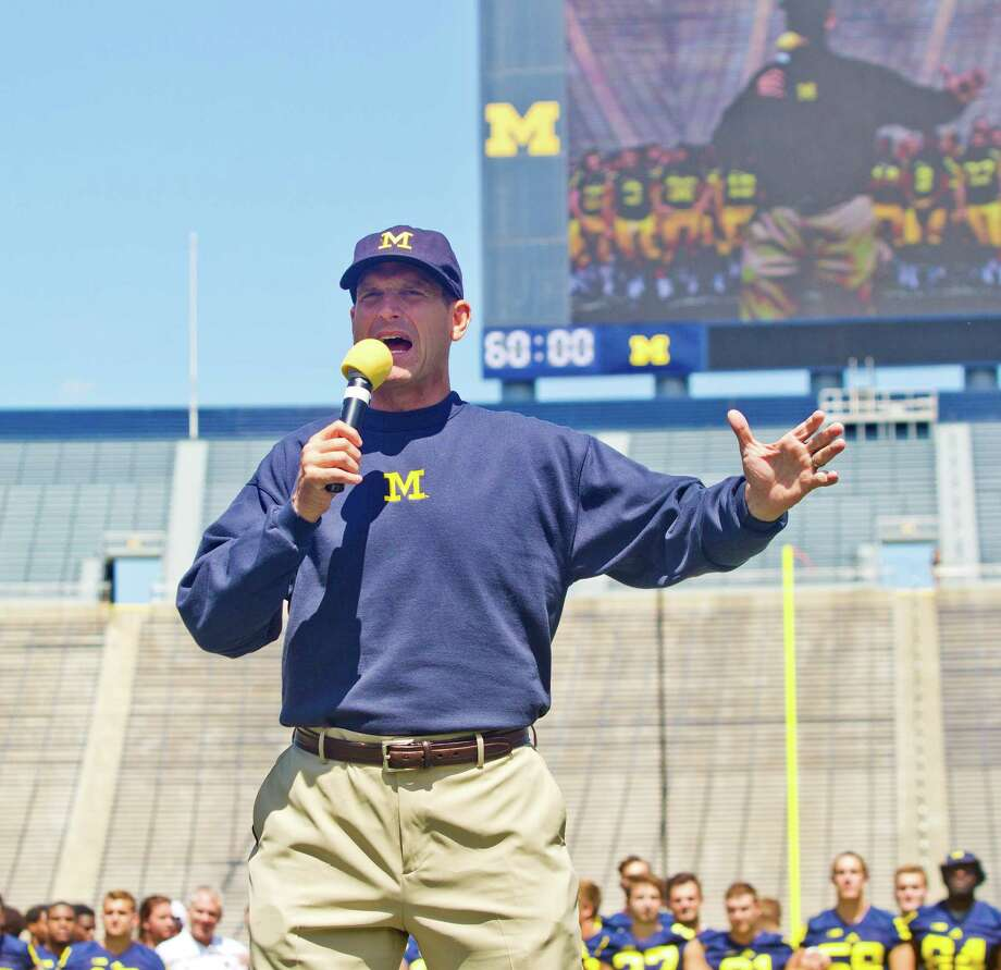 Michigan head coach Jim Harbaugh introduces his team to fans and media at Michigan Stadium, during the NCAA college football team's annual media day in Ann Arbor, Mich., Thursday, Aug. 6, 2015. (AP Photo/Tony Ding) ORG XMIT: MITD101 Photo: Tony Ding / FR143848 AP
