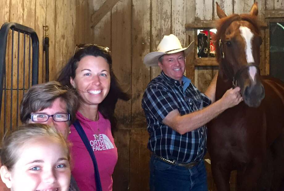 """Trainer Larry Jones is known as one of the nice guys in racing. He has two fillies entered in Saturday's Alabama Stakes at the Spa. Wednesday morning, fans of one of them, I'm a Chatterbox, happened by the barn and asked Jones if they could see their favorite filly. """"Sure,"""" Larry said. """"Come on down."""" Jones invited these three to come into the stall with him and hang out with I'm a Chatterbox. Don't see that every day. Right or wrong? (Tim Wilkin / Times Union)"""