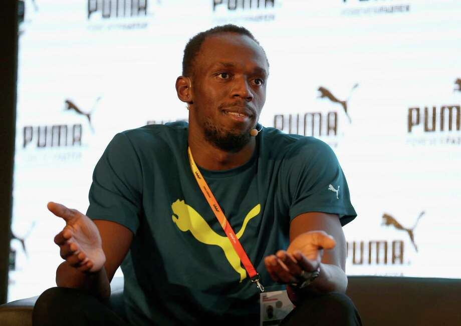 BEIJING, CHINA - AUGUST 20:  Usain Bolt of Jamaica talks with the media during a press conference prior to the beginning of the IAAF World Championships on August 20, 2015 in Beijing, China.  (Photo by Andy Lyons/Getty Images) ORG XMIT: 570272543 Photo: Andy Lyons / 2015 Getty Images