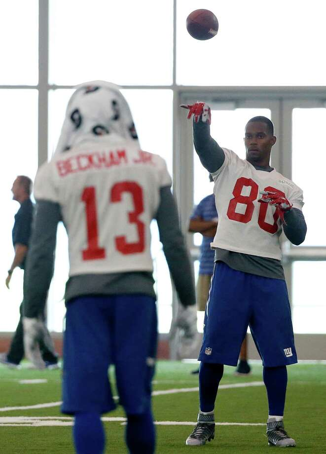 New York Giants wide receiver Odell Beckham (13) and wide receiver Victor Cruz (80) play catch during NFL football mini camp, Tuesday, June 16, 2015, in East Rutherford, N.J. (AP Photo/Julio Cortez) ORG XMIT: NJJC118 Photo: Julio Cortez / AP