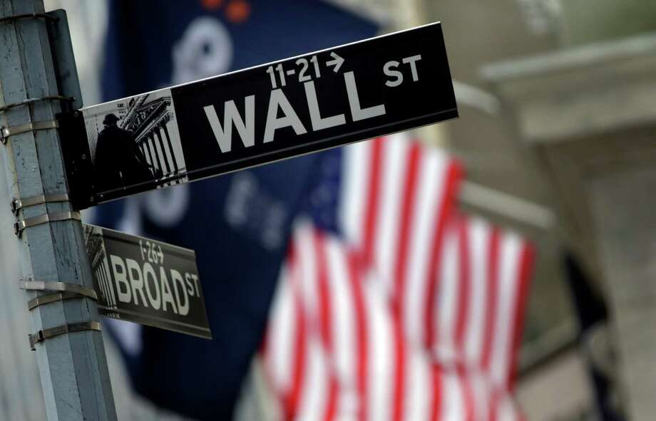 FILE - This Oct. 2, 2014 file photo shows a Wall Street sign adjacent to the New York Stock Exchange, in New York. A fresh sell-off of Chinese shares prompted renewed jitters across global markets on Thursday, Aug. 20, 2015. (AP Photo/Richard Drew, File) Photo: Richard Drew, STF / AP