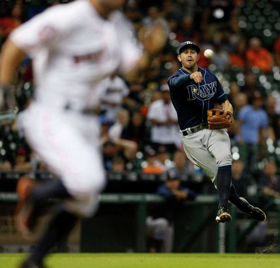After charging in to field Jose Altuve's short grounder, Rays third baseman Evan Longoria fires the ball across the diamond to secure the final out in Thursday night's 1-0 Astros loss. Photo: Karen Warren, Staff / © 2015 Houston Chronicle