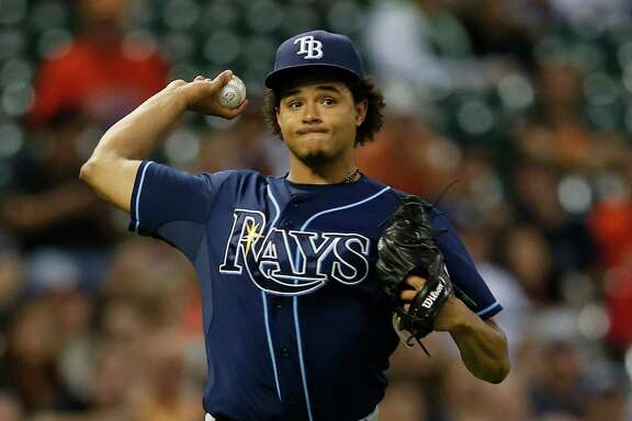 Tampa Bay Rays starting pitcher Chris Archer (22) makes the throw to first base as Houston Astros left fielder Preston Tucker (20) grounded out during the sixth inning of an MLB game at Minute Maid Park on Thursday, Aug. 20, 2015, in Houston.( Karen Warren / Houston Chronicle )