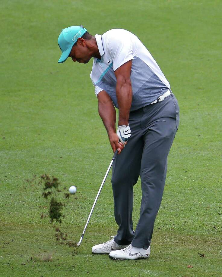 GREENSBORO, NC - AUGUST 20:  Tiger Woods plays his second shot on the ninth hole during the first round of the Wyndham Championship at Sedgefield Country Club on August 20, 2015 in Greensboro, North Carolina.  (Photo by Kevin C. Cox/Getty Images) ORG XMIT: 527946981 Photo: Kevin C. Cox / 2015 Getty Images