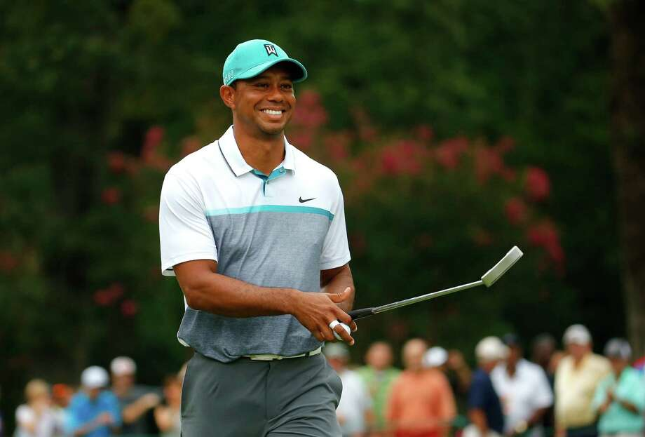 GREENSBORO, NC - AUGUST 20:  Tiger Woods reacts after sinking a birdie putt on the 13th green during the first round of the Wyndham Championship at Sedgefield Country Club on August 20, 2015 in Greensboro, North Carolina.  (Photo by Kevin C. Cox/Getty Images) Photo: Kevin C. Cox, Staff / 2015 Getty Images