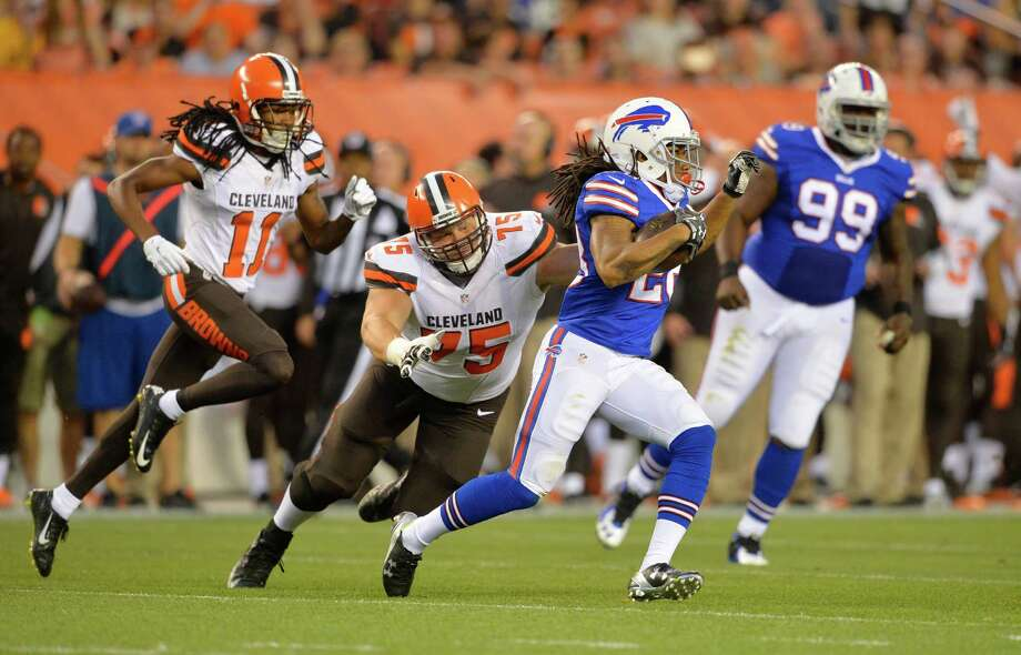 Buffalo Bills cornerback Ronald Darby (28) returns an interception during the first quarter as Cleveland Browns guard Joel Bitonio (75) tries to tackle him during an NFL preseason football game, Thursday, Aug. 20, 2015, in Cleveland. (AP Photo/David Richard) ORG XMIT: CDS106 Photo: David Richard / FR25496 AP