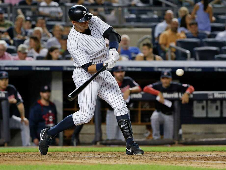 New York Yankees' Alex Rodriguez swings on a home run during the fourth inning of a baseball game against the Cleveland Indians on Thursday, Aug. 20, 2015, in New York. (AP Photo/Frank Franklin II) ORG XMIT: NYY108 Photo: Frank Franklin II / AP