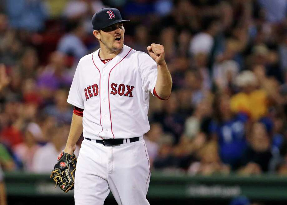 Boston Red Sox starting pitcher Wade Miley pumps his fist after Mookie Betts snagged a a line drive by Kansas City Royals' Alex Rios to end the top of the seventh inning of a baseball game at Fenway Park in Boston, Thursday, Aug. 20, 2015. (AP Photo/Charles Krupa) ORG XMIT: MACK111 Photo: Charles Krupa / AP