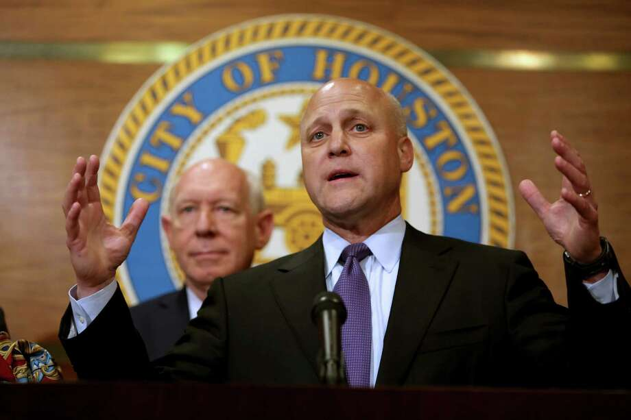Mitch Landrieu, right, mayor of New Orleans, and former Houston Mayor Bill White, left, along with Mayor Annise Parker, not shown, and other leaders discuss New Orleans' growth and recovery over the last ten years and to thank the people of Houston for their generosity and open arms at a press conference at City Hall Thursday, Aug. 20, 2015, in Houston, Texas. Photo: Gary Coronado, Houston Chronicle / © 2015 Houston Chronicle