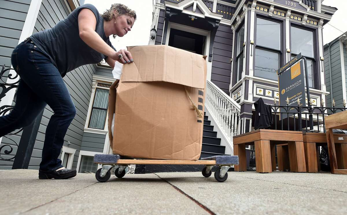 Sarah Bibby of Gigi Park helps to stage a home being prepped for sale in San Francisco on Thursday, August 20, 2015. Many home sellers are waiting to list their homes until September; one of the hottest months of the year for real estate sales. (JOSH EDELSON / SPECIAL TO THE CHRONICLE)