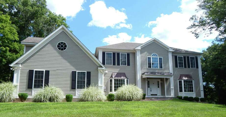 The house at 106 Greens Farms Road is on the market for $1,199,000. Photo: Contributed / Contributed Photo / Westport News