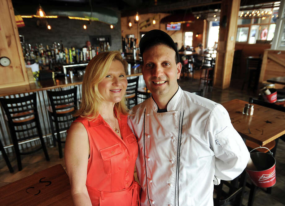 Husband and wife restauranteurs Ania and Joe Catalano, of Milford, in their new Joey C's Boathouse restaurant on the Housatonic River in the Dock Shopping Center in Stratford, Conn. on Wednesday, August 12, 2015. The new restaurant features more seafood offerings, and less barbecue, than their successful Milford restaurant, Joey C's Roadhouse. Photo: Brian A. Pounds / Hearst Connecticut Media / Connecticut Post