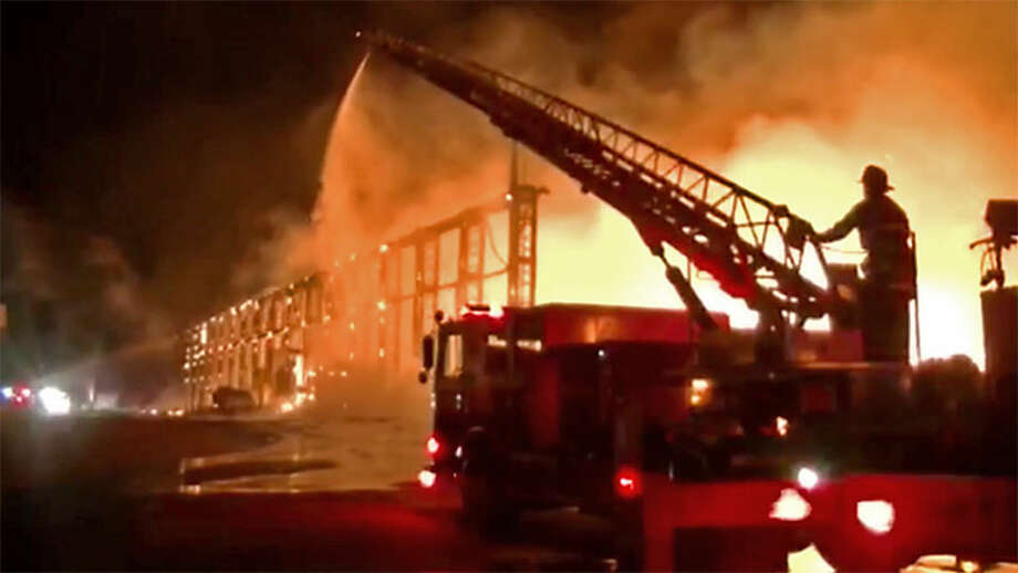 The fire broke out at Alco Metal & Iron Company just before midnight. Photo: CBS San Francisco