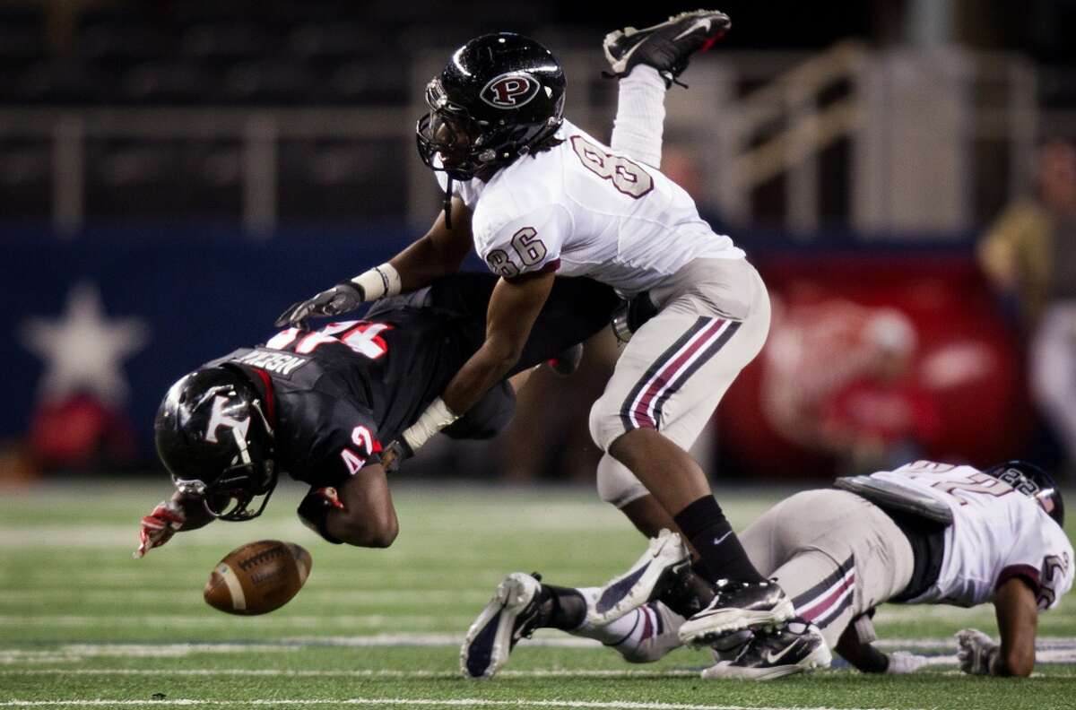 Euless Trinity running back Serge Nseka fumbles as he is hit by Pearland defensive end Sam Ukwuachu (86) during the first half of the Class 5A Division 1 state championship game Dec. 18, 2010, at Cowboys Stadium in Arlington.