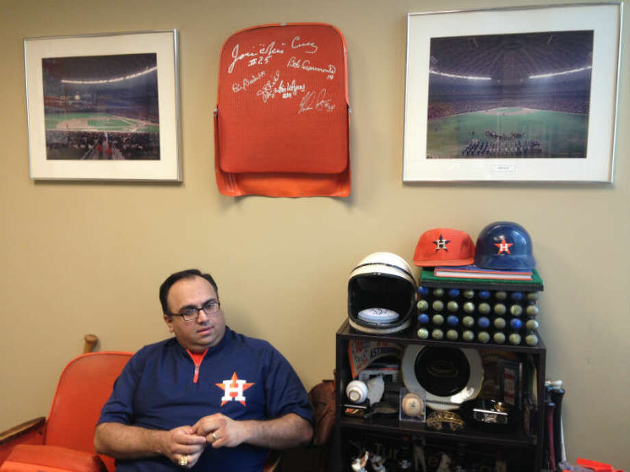 Houston Astros authentication manager Mike Acosta relaxes in set of Astrodome seats in his Minute Maid Park office. He has 21 seats at home in various colors from all over the Dome.  Photo: Craig Hlavaty