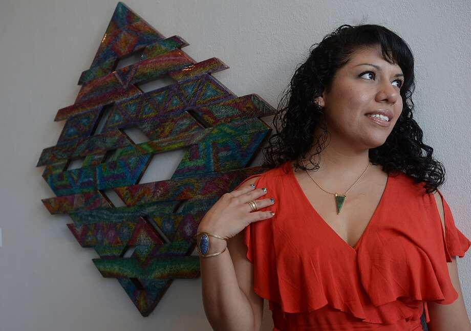 """Beaumont artist Ines Alvidres has a show opening August 23 in the cafe at the Art Museum of Southeast Texas. """"My Journey"""" will be on display through November 1. Originally from Mexico, Alvidres moved to Beaumont 15 years ago and started making art only 3 - 4 years ago. Using rich, vibrant colors and line, the self-taught artist describes her process as a meditative act that is also influenced by the music she listens to while creating. She feels they come from a place deep in her core that finds its way out. While working, she says, """"I don't know where the next lines will go and where they will meet,"""" adding, """"I have no rules that I follow. The work is made with no sense of technique or control. It's very raw and authentic. Because I never learned the rules, I don't feel like I'm breaking them."""" An artist reception will be held on the opening  of the exhibit from 2 - 4 p.m. Photo taken Tuesday, August 11, 2015 Kim Brent/The Enterprise Photo: Kim Brent/The Enterprise"""