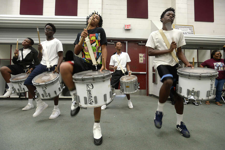 "Central High School's marching band drum line , including Kobe Grimes, 17, (left) and Jaccari Jones, 16, perform while keeping the beat during practice in the band room Wednesday. The group's spirited performances alongside the dance team have earned them ""Band of the Week"" honors in past seasons, a title which they hope to reclaim again this year.   Photo taken Wednesday, August 19, 2015  Kim Brent/The Enterprise Photo: Kim Brent / Beaumont Enterprise"