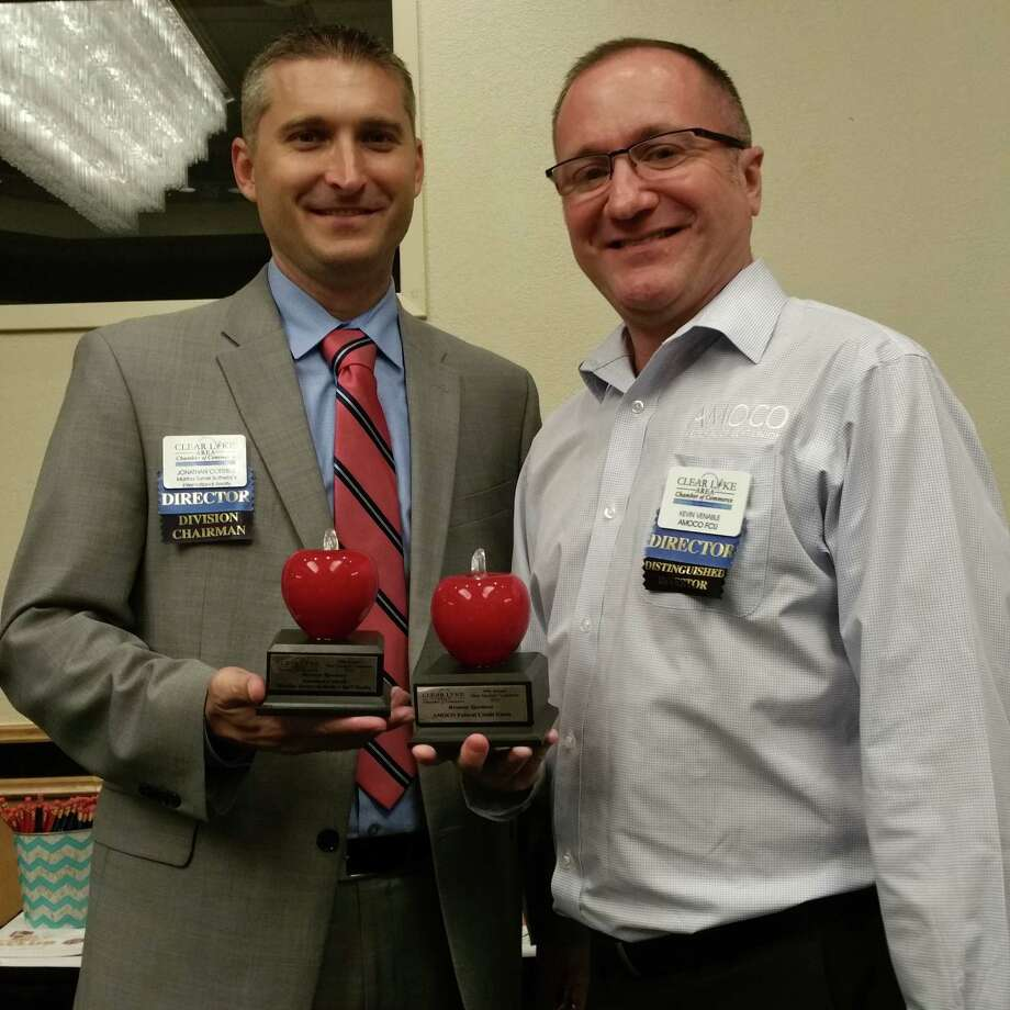 Martha Turner Sotheby's International Realty's agent Jonathan Cottrell and his fellow Clear Lake Chamber board member Kevin Venable, with Amoco FCU, show their sponsorship recognition awards.
