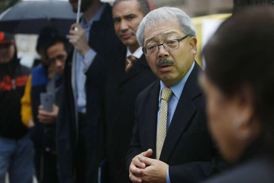 San Francisco Mayor Ed Lee in December talks with residents in the Balboa Park neighborhood where homes and businesses were flooded by rainstorms. Photo: Lea Suzuki, The Chronicle
