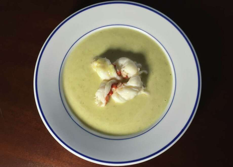 Butter-poached lobster tail in Hatch chile sauce Photo: Edmund Tijerina / San Antonio Express-News