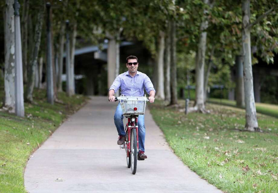 There's no need to walk when you can jump on a B-Cycle for a ride around town. Photo: Gary Coronado, Staff / © 2015 Houston Chronicle