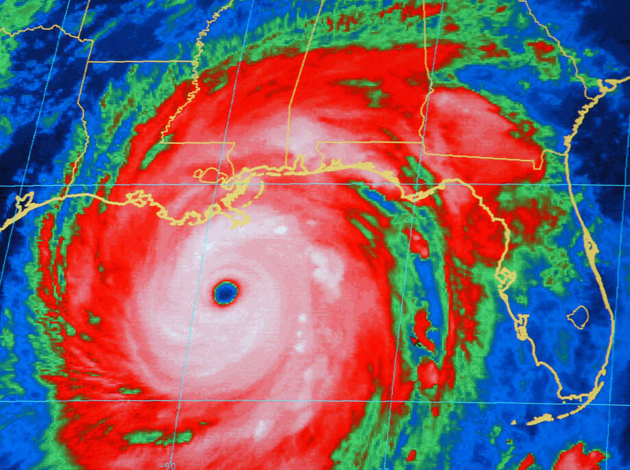 A National Oceanic and Atmospheric Administration infrared satellite images shows the outer bands of Hurricane Katrina well ashore on the northern Gulf coast and the center of the storm about 165 miles, south-southeast of New Orleans at 8:15 p.m. CT Sunday, Aug. 28, 2005.  Photo: NOAA, AP / AP