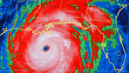 A National Oceanic and Atmospheric Administration infrared satellite images shows the outer bands of Hurricane Katrina, well ashore on the northern Gulf coast and the center of the storm about 165 miles, south-southeast of New Orleans at 8:15 p.m. CT Sunday, Aug. 28, 2005. (AP Photo/NOAA) Katrina10_828