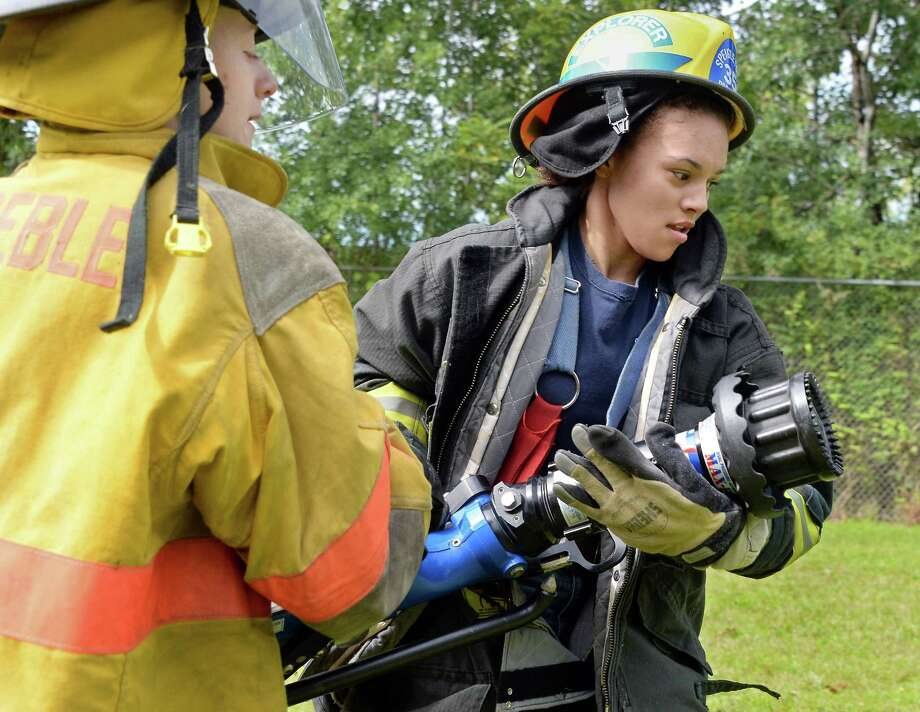 Franchesca Hulbert, 15, left, of Preble and Julianna Keeler, 15, of Speigletown compete in a hose relay during the Firemen's Association of the State of New York will hold its 7th Annual Youth Day at the Rensselaer Fire Training Center Wynantskill (John Carl D'Annibale / Times Union) Photo: John Carl D'Annibale / 00033056A