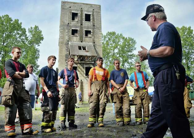 NYS fire instructor Buddy Poirier, right, with students during the Firemen's Association of the State of New York will hold its 7th Annual Youth Day at the Rensselaer Fire Training Center Wynantskill (John Carl D'Annibale / Times Union) Photo: John Carl D'Annibale / 00033056A