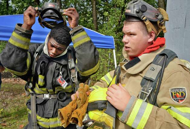 Roshane Murray, left, 17, of Hudson and Bryce Premo, 17 of Fairville after a search and rescue drill during the Firemen's Association of the State of New York will hold its 7th Annual Youth Day at the Rensselaer Fire Training Center Wynantskill (John Carl D'Annibale / Times Union) Photo: John Carl D'Annibale / 00033056A