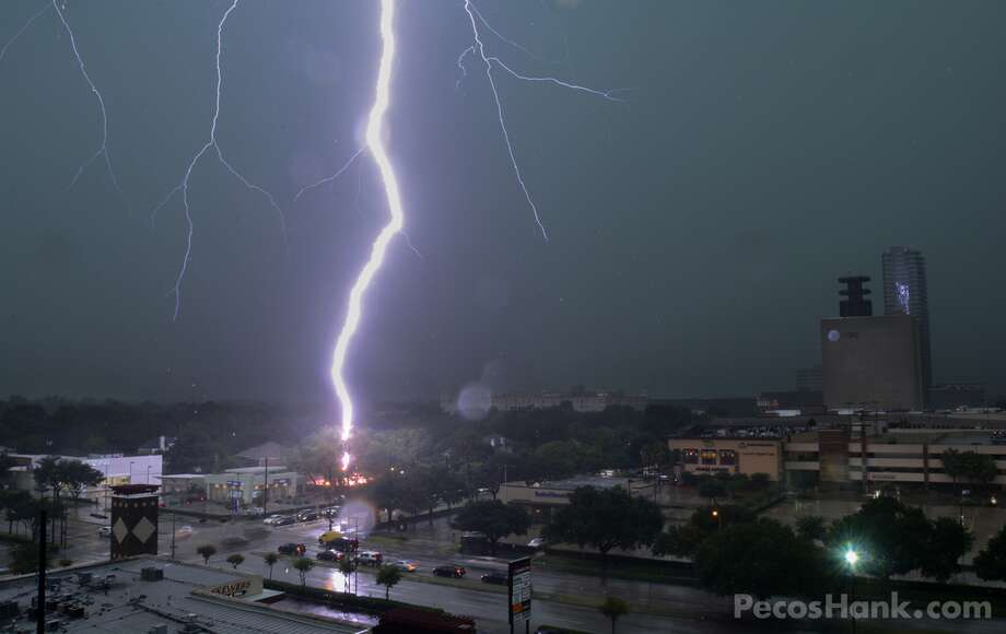 The Bayou City's own storm chaser Hank Schyma was able to capture a lightning strike during Houston's wicked weather on Thursday. Shot near the corner of Richmond and Weslayan, a lightning strike is shown hitting the ground, lighting it up in a pinkish hue.