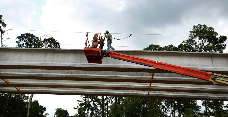 Workers work on a ramp from the Hardy Toll road Wednesday, Aug. 19, 2015, in Houston.  Photo: Steve Gonzales, Houston Chronicle / © 2015 Houston Chronicle