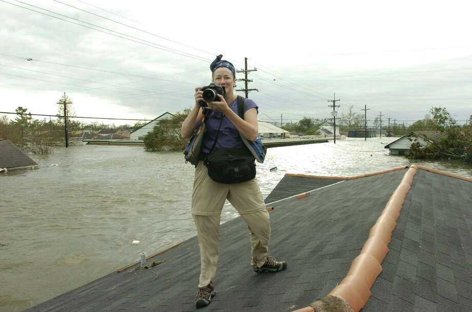 Melissa Phillip and a Times Picayune photographer, Alex Brandon, arrived  in a boat with SWAT officers who worked to rescue resident  Lois Rice. Photo: Alex Brandon, Times Picayune / Times Picayune