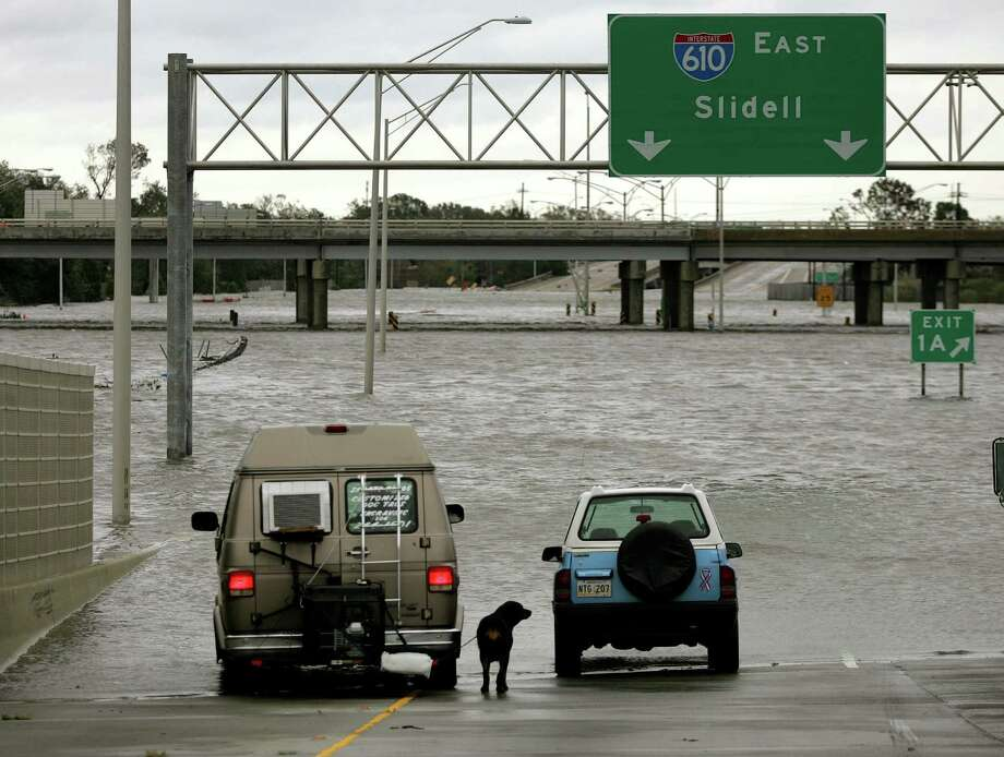 Flood waters from Hurricane Katrina bar drivers from moving down Interstate 610 near Interstate 10 in New Orleans.  Photo: KHAMPHA BOUAPHANH, KRT / FORT WORTH STAR-TELEGRAM