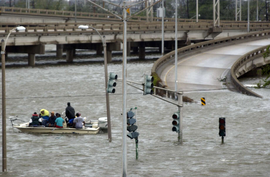 Rescue workers take residents to a ramp on Interstate 10 after a tidal surge from Hurricane Katrina overwhelmed a levee. Photo: DOUGLAS R. CLIFFORD, AP / ST. PETERSBURG TIMES