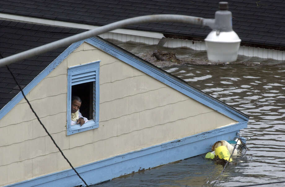 An unidentified resident awaits rescue in the Eighth Ward of New Orleans. Photo: CLIFFORD, DOUGLAS R., AP / ST. PETERSBURG TIMES